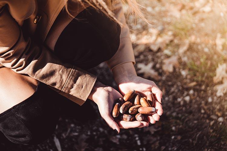 woman holding acorns